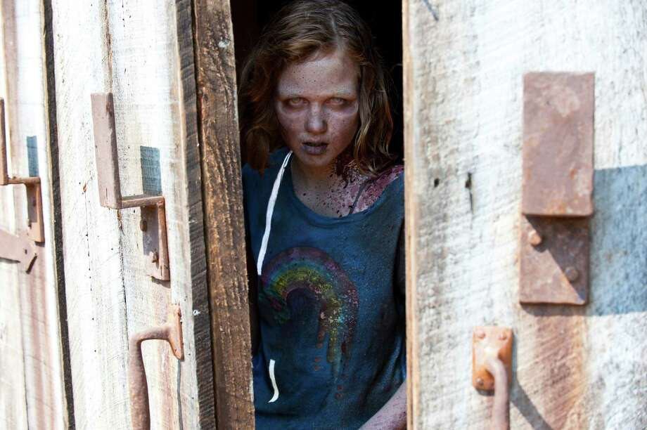 A little girl comes out and the group soon realizes that it's Sophia. All the time they spent looking for her was a waste. Carol breaks down as Daryl tries to comfort her. Rick puts little Sophia to rest. Photo: Gene Page/AMC, Gene Page/Courtesy Of AMC / AMC