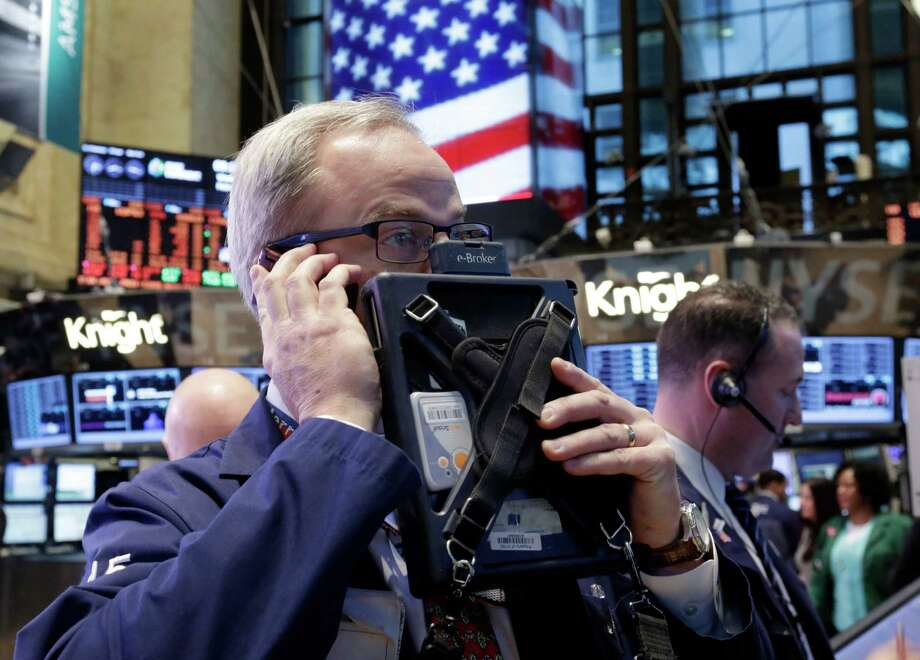 In this Wednesday, Feb. 6, 2013 photo, trader David O'Day works on the floor of the New York Stock Exchange, in New York. World stock markets were mostly higher Friday, Feb. 8, 2013, boosted by better-than-expected trade data from China that provided new evidence of an upswing in the world's second-largest economy. (AP Photo/Richard Drew) Photo: Richard Drew