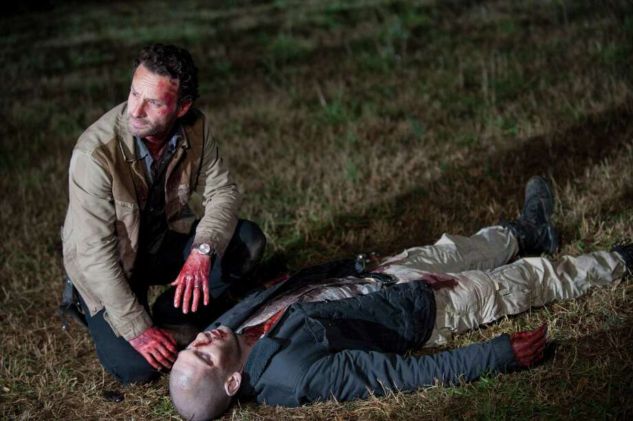 Rick inspects Shane's body, but doesn't find any bite marks or scratches on him. Photo: Gene Page, Gene Page/Courtesy Of AMC