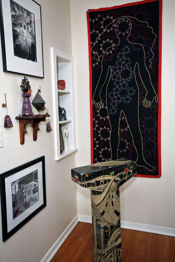 Laurel GibsonÕs ceramics and embroidered artwork decorate the living room. Photo: Danny Warner, For The Express-News
