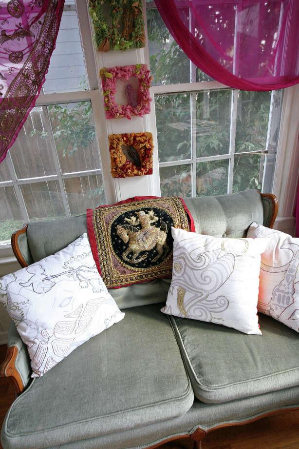 Laurel Gibson made the pillows on the love seat in the design studio. Photo: Danny Warner, For The Express-News