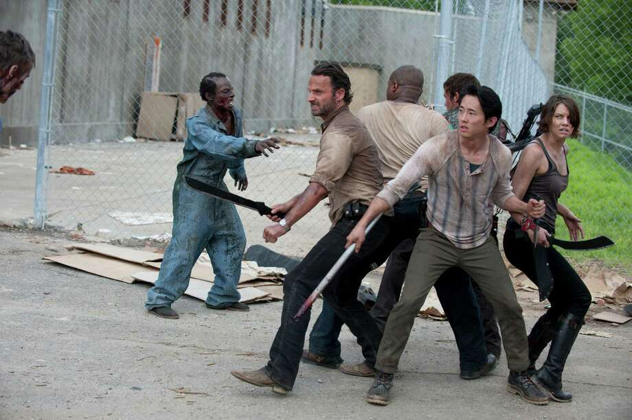 The groups fights off a group of walkers in the prison field. Photo: Gene Page/Courtesy Of AMC