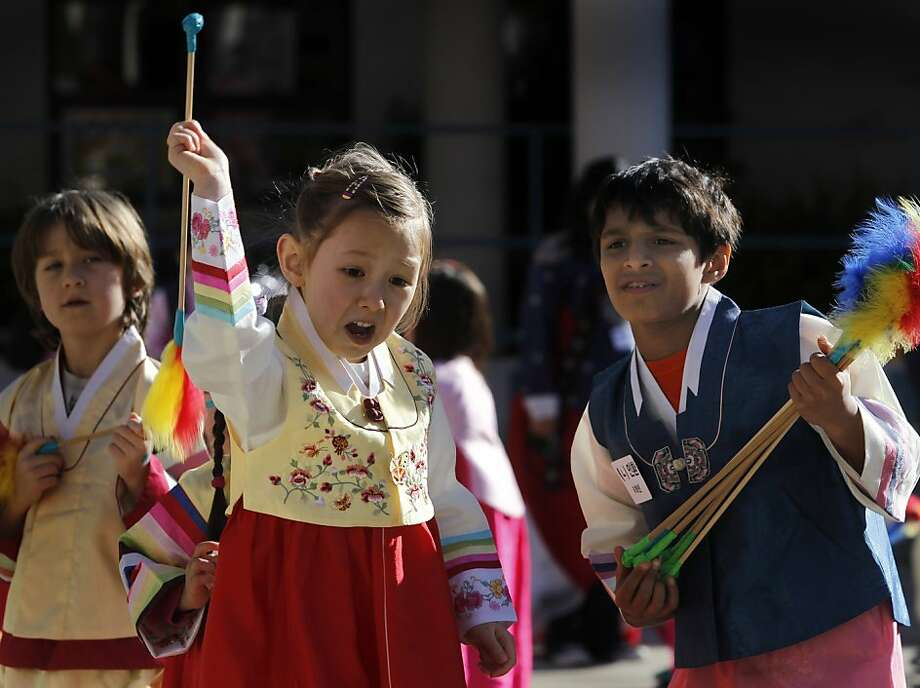 Simone Willets tosses an arrow while playing a game of tuho, with help from her classmate Adrien Stroumza (right), during a celebration of Seol Nal, the Korean Lunar New Year, at the Claire Lilienthal School in San Francisco, Calif. on Friday, Feb. 8, 2013. Students in the Korean-immersion program wore traditional hanbok outfits and participated in a variety of activities to celebrate the lunar new year, which begins Sunday. Photo: Paul Chinn, The Chronicle