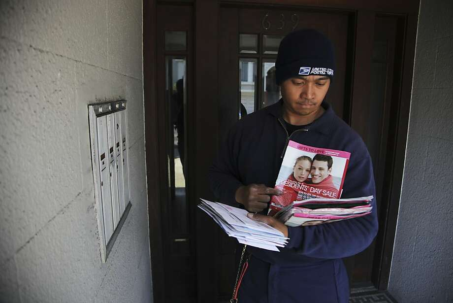 Postal worker Grinje Fernandez delivers mail in San Francisco's Richmond District last week. Photo: Jim Wilson, New York Times