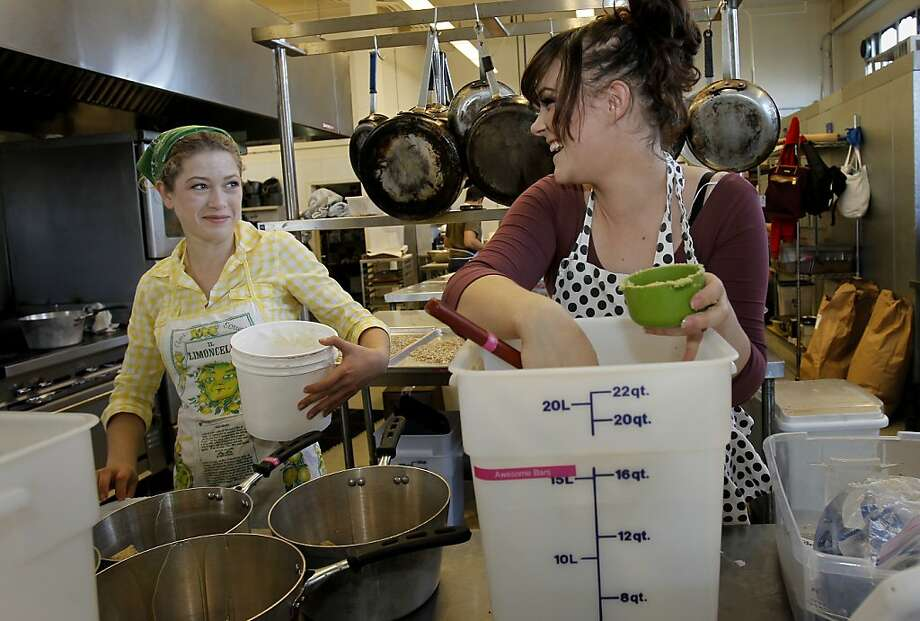 Stephanie Melnik (left) and Autumn Valjien put together the next batch of locally made Awesome energy bars. Photo: Brant Ward, The Chronicle