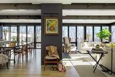 Light from windows floods the living and dining rooms in the home of Town & Country editor Jay Fielden.
