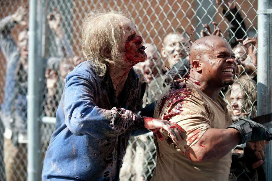 T-Dog gets bitten by walkers and sacrifices himself so Carol can get away. The remaining members have a burial for T-Dog, Lori and, after finding only her headband, Carol. Photo: Gene Page/Courtesy Of AMC
