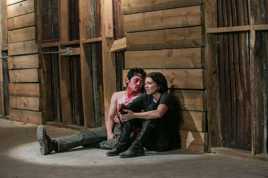 Despite being beat up, Glenn and Maggie refuse to talk. Only when Glenn is threatened with death does Maggie reveal where her group is hiding. Photo: Tina Rowden/Courtesy Of AMC