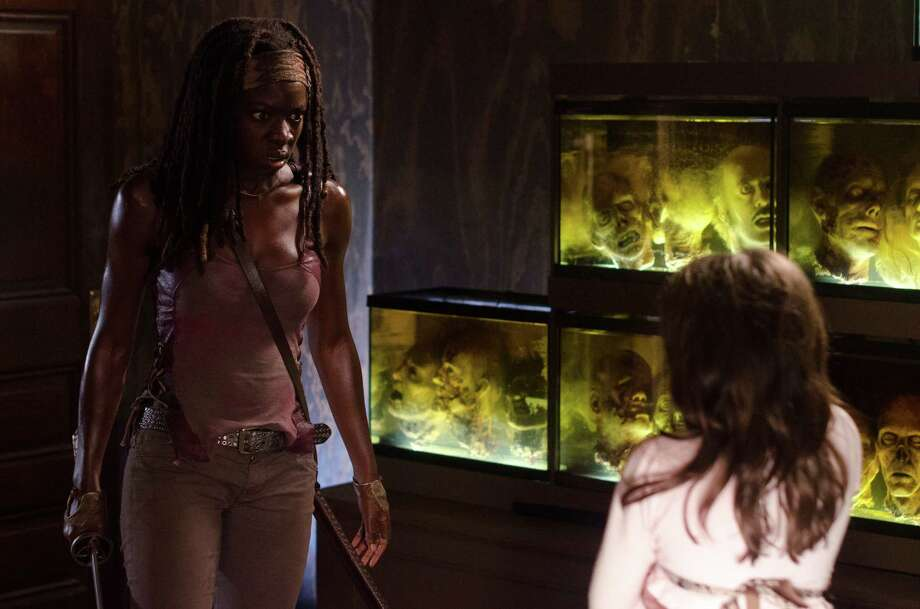 Michonne about the kill The Govenor's undead daughter. Photo: Tina Rowden/Courtesy Of AMC