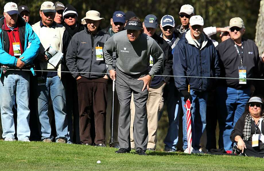 AT&T defending champion Phil Mickelson lines up his third shot on 16th hole at Spyglass Hill Golf Course during the second round of the AT&T Pebble Beach Pro-Am golf tournament on Friday, Feb. 8th, 2013, in Pebble Beach, Calif. Photo: Michael Macor & Lance Iversen, The Chronicle