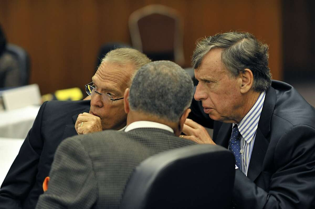 UC Regents Norm Pattiz (left) and Dick Blum take part in a private discussion during the regents' meeting at the UC Mission Bay campus.