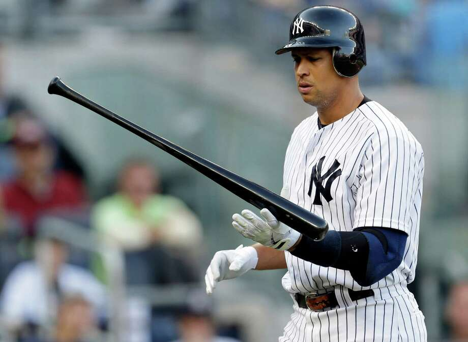 Alex Rodriguez's latest drug allegations have Yankees officials concerned, but the issue is out of their hands while Major League Baseball investigates. Photo: Paul Sancya, STF / AP