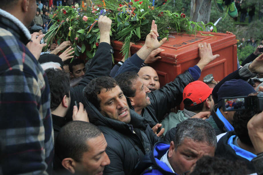 Pallbearers carry the coffin of assassinated opposition leader Chokri Belaid on Friday as thousands of Tunisians gather at el Jallez cemetery near Tunis. The killing sent shock waves across the Middle East. Photo: STR / AP