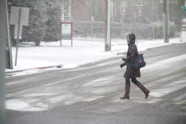 A pedestrian heads up Summer Street during a snow storm in Stamford, Conn. on Friday, Feb. 8, 2013. Photo: Chris Preovolos / 2011
