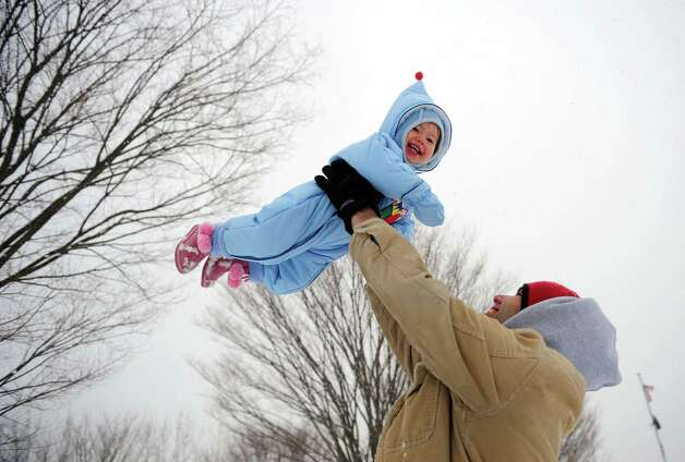 Sasha Bratt throws his 15-month-old daughter Mina into the snowy air at Veteran's Memorial Park in Shelton, Conn. Friday, Feb. 8, 2013. Photo: Autumn Driscoll