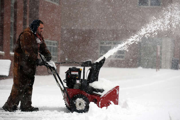 Greg Klancko runs a snow blower in Bridgeport, Conn., Feb. 8th, 2013. Photo: Ned Gerard / Connecticut Post