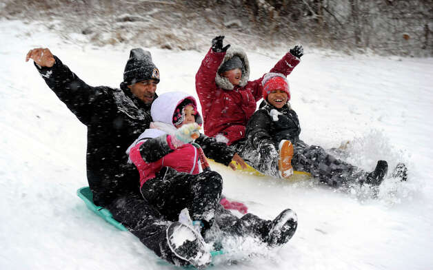 Sledding on a hill on Mill Ridge Road in Danbury, Conn. during Friday's snowstorm are from left, Dominick Craig with his daughter Aaliyah, 8, and Jaeden Fermon, 8, and Ozzy Priar, 9, Feb. 8, 2013. Photo: Carol Kaliff / The News-Times