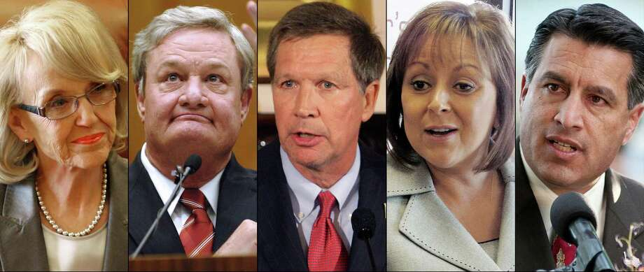 FILE - This combination of undated file photos shows Republican Governors, from left: Jan Brewer, Ariz.; Jack Dalrymple, N.D.; John Kasich, Ohio; Susana Martinez, N.M., and Brian Sandoval, Nev. While far from voicing a consensus opinion in their party, the governors, along with Michigan Gov. Rick Snyder, are six GOP governors who in the past two months who have joined a growing number of Republican governors now buying into parts of the system as the financial realities of their states? medical costs begin to counterbalance the fierce election politics of the issue. (AP Photo/File) Photo: STF / AP