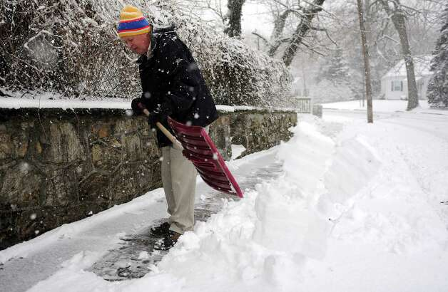 Ed Scofield shovels his sidewalk during Friday's blizzard in Stamford, Conn., on February 8, 2013. Scofield said he tries to shovel every six inches of snow to keep ahead of the accumulation. Photo: Lindsay Perry / Stamford Advocate