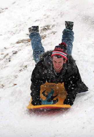 A sledder goes over a jump in Cummings Park during Friday's blizzard in Stamford, Conn., on February 8, 2013. Photo: Lindsay Perry / Stamford Advocate