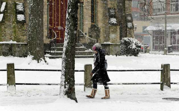 A woman walks through downtown during Friday's blizzard in Stamford, Conn., on February 8, 2013. Photo: Lindsay Perry / Stamford Advocate