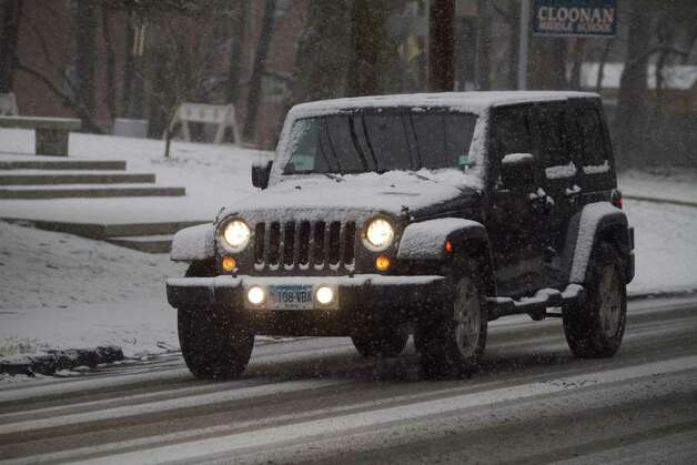 A driver heads down West North St. in Stamford, Conn. on Friday, Feb. 8. 2013. Photo: Chris Preovolos / 2011
