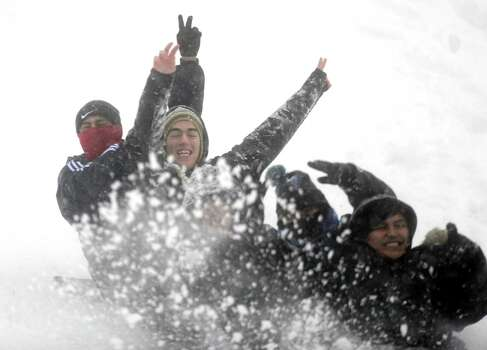 Teenagers sled down the hill behind Derby Middle School in Derby, Conn. Friday, Feb. 8, 2013. Photo: Autumn Driscoll