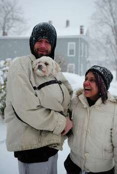 Fred and Liz Smith take their dog Bo for a snowy walk in Ansonia, Conn. Friday, Feb. 8, 2013. Photo: Autumn Driscoll