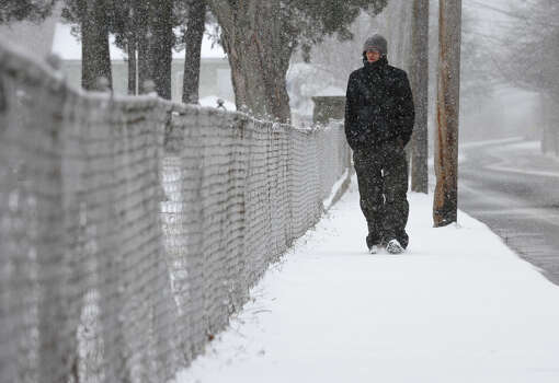Steve Bailey, of Seymour, walks home from his friend's house after helping him get ready for the major snow storm hitting our region today in Seymour, Conn. on Friday February 8, 2013. Photo: Christian Abraham / Connecticut Post