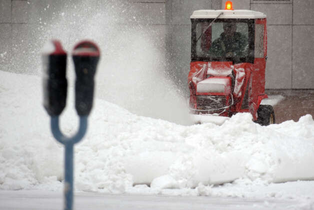 A snow plow moves snow along Main Street, in downtown Bridgeport, Conn., Feb. 8th, 2013. Photo: Ned Gerard / Connecticut Post