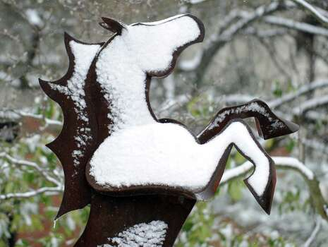 A sculpture of a horse is covered with snow at the top of Greewich Avenue during the snowstorm that hit Greenwich, Conn., Friday, Feb. 8, 2013. Photo: Bob Luckey / Greenwich Time