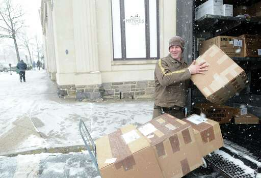UPS deliveryman Bobby Whritenour works on Greenwich Avenue during the snowstorm that hit Greenwich, Conn., Friday, Feb. 8, 2013. Photo: Bob Luckey / Greenwich Time