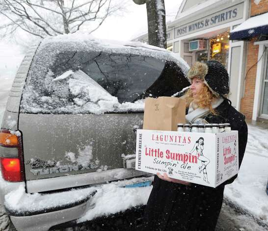 Shannon Bassalik of Cos Cob loads up her vehicle with alcohol that she purchasedfrom Post Wines & Spirits in Cos Cob for an upcoming ski trip during the storm that hit Greenwich, Conn., Friday, Feb. 8, 2013. Photo: Bob Luckey / Greenwich Time