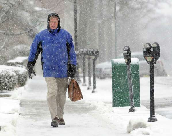 Steve Skoczylas heads down Greenwich Avenue as he leaves work early during the snowstorm that hit Greenwich, Conn., Friday afternoon, Feb. 8, 2013. Photo: Bob Luckey / Greenwich Time