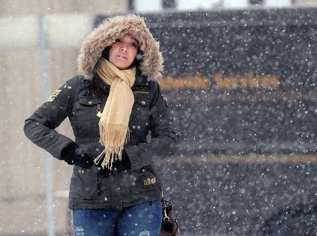 Ana DaSilva of the Bronx, N.Y., heads down Greenwich Avenue as she leaves work early to catch a train home during the snowstorm that hit Greenwich, Conn., Friday afternoon, Feb. 8, 2013. Photo: Bob Luckey / Greenwich Time