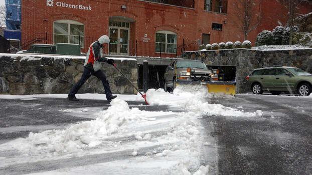 A man shovels the walkway along Amongerone Crossway as a blizzard moves into Greenwich, Conn., Feb. 8, 2013. Photo: Keelin Daly / Keelin Daly