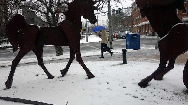 Walking along Putnam Avenue as a blizzard moves into Greenwich, Conn., Feb. 8, 2013. Photo: Keelin Daly / Keelin Daly