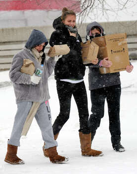 Students at Western Connecticut State University in Danbury, Conn. take food from the Student Center to take to their dorms at the college's westside campus during Friday's snowstorm, Feb. 8, 2013. Photo: Carol Kaliff / The News-Times