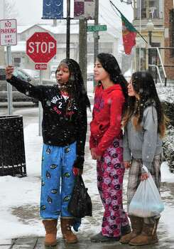 Nieman Riley, left, Alondra O'Campo, center, and Karina Baltazar, all 15, take their photo in the snow in Danbury Friday Feb. 8, 2013. Photo: Michael Duffy / The News-Times