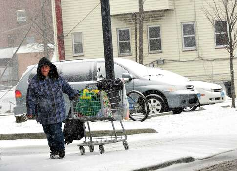 A woman makes her way through the snow in Danbury Friday, Feb. 8, 2013. Photo: Michael Duffy / The News-Times