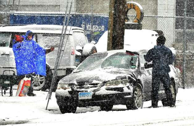 Snow falls in Danbury as residents cope with the storm  Friday Feb. 8, 2013. Photo: Michael Duffy / The News-Times