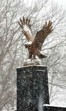 Snow falls on the Korean War monument at Rogers Park in Danbury Friday Feb. 8, 2013. Photo: Michael Duffy / The News-Times