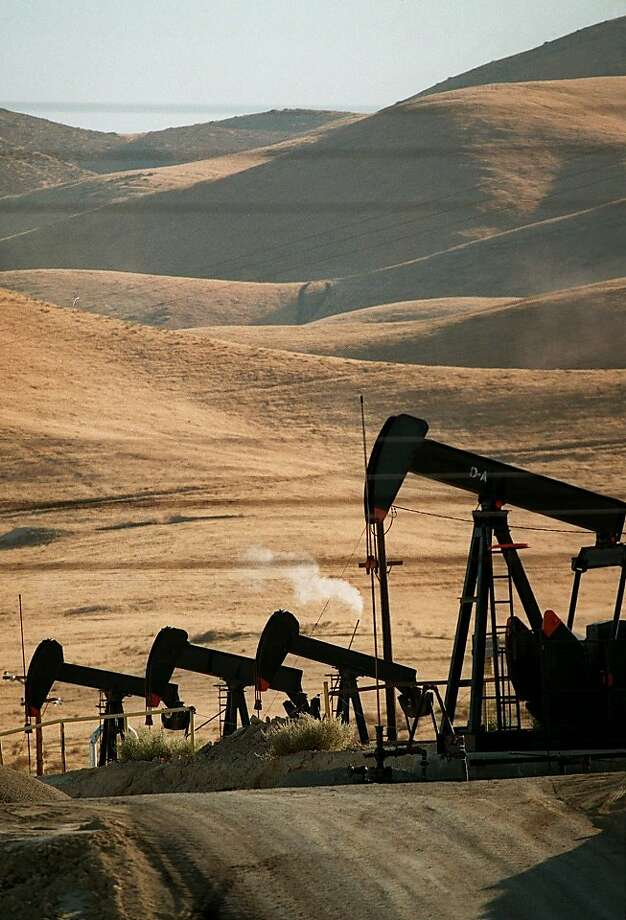 In a file photo, pumps work the Midway-Sunset oil field west of Taft (Kern County). The field, discovered in 1894, uses a high level of energy to extract its remaining oil. Photo: Susan Sterner, AP
