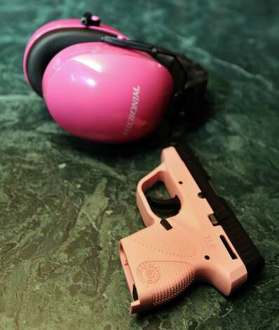 Brenda Wells Deshotel shows us her Taurus 738 Pink TCP .380 handgun on Friday, February 8, 2013 , at her home in Orange.  Deshotel received it for Christmas this past December. She also prides herself on her pink Winchester earmuffs. Photo taken: Randy Edwards/The Enterprise Photo: Randy Edwards