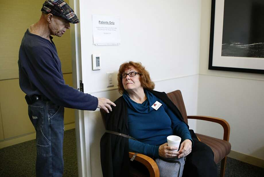Cancer patient Ron Loewenstein meets volunteer driver Wendy Khoshnevis in the waiting room after chemotherapy in San Jose. Photo: Liz Hafalia, The Chronicle