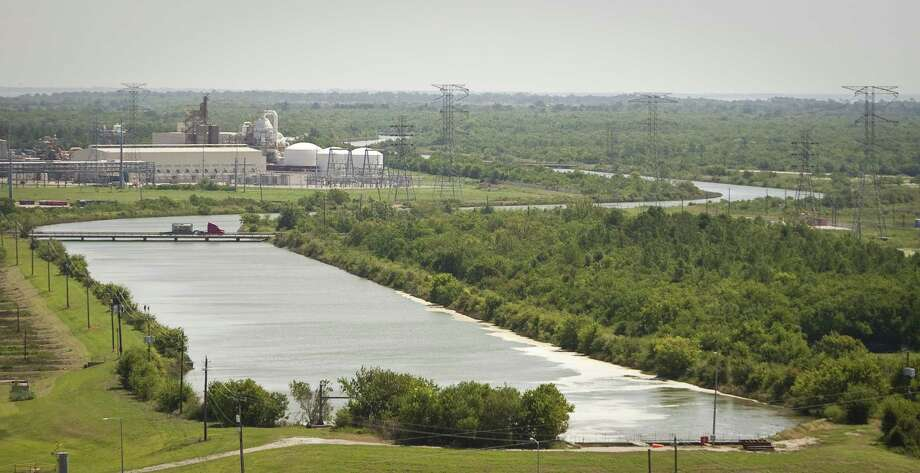 A 6½-mile-long canal linking NRG Energy's Cedar Bayou power plant in Baytown with Trinity Bay allows water warmed during plant operations to cool before it enters the bay. Photo: Photos By Nick De La Torre / Houston Chronicle