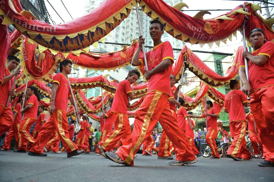 Performers take part in a dragon dance to celebrate Chinese Lunar New Year of the Snake in China town in Manila on February 8, 2013. The Chinese Lunar New Year of the Snake will be celebrated on February 10. Photo: TED ALJIBE, AFP/Getty Images / AFP