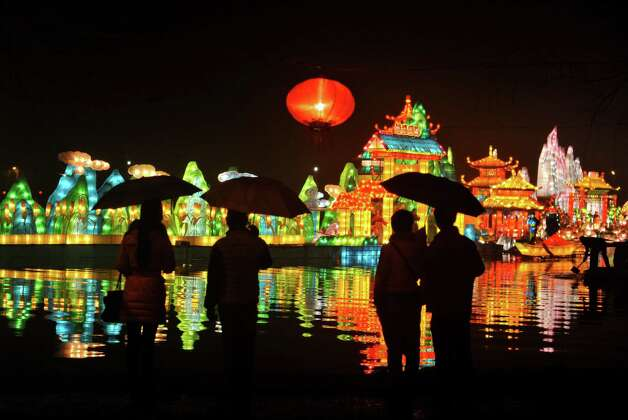 Visitors admire the flowery lanterns at a lantern show held in conjunction with the upcoming Lunar New Year celebrations in Fuyang city in central China's Anhui province on Sunday, Feb. 3, 2013. Photo: Associated Press / CHINATOPIX
