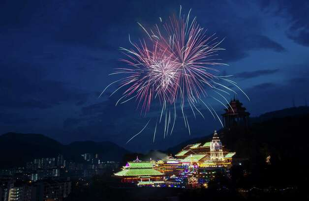 Fireworks explode over Kek Lok Si Buddhist temple with lighting decorations as part of the upcoming Chinese New Year celebrations in Penang Island, northwestern Malaysia. Chinese Lunar New Year falls on Feb. 10. Photo: Gary Chuah, Associated Press / AP
