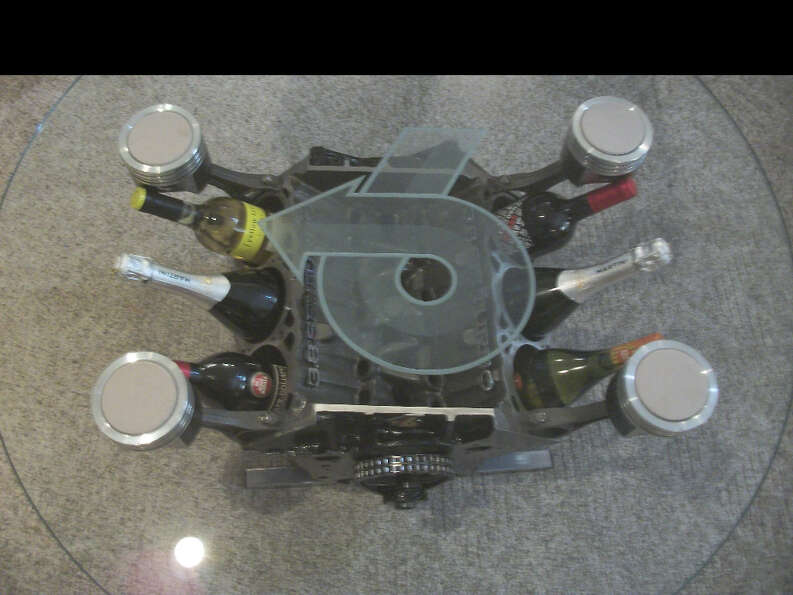 Mahnke created this coffee table and wine storage unit from a V6 Buick engine.